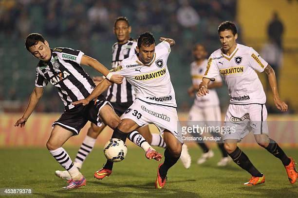 Pablo of Figueirense battles for the ball with Edilson of Botafogo during a match between Figueirense and Botafogo as part of Campeonato Brasileiro...