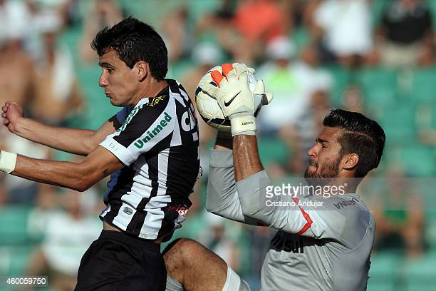 Pablo of Figueirense fight for the ball with goalkeeper Alisson of Internacional during a match between Figueirense and Internacional as part of...