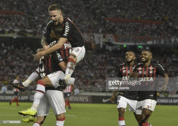 Pablo of Paranaense celebrates with teammate Leo Pereira after scoring the first goal to Junior during the first leg of the final of Copa...