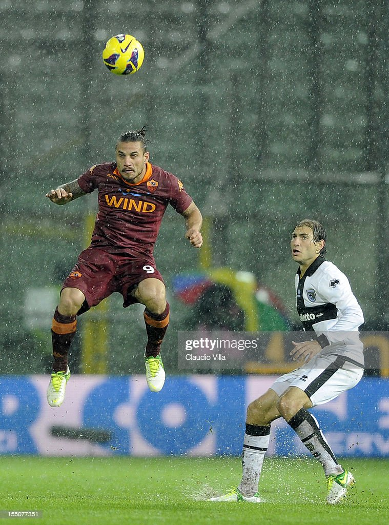 Pablo Osvaldo of AS Roma (L) and Gabriel Paletta of Parma FC compete for the ball during the Serie A match between Parma FC and AS Roma at Stadio Ennio Tardini on October 31, 2012 in Parma, Italy.