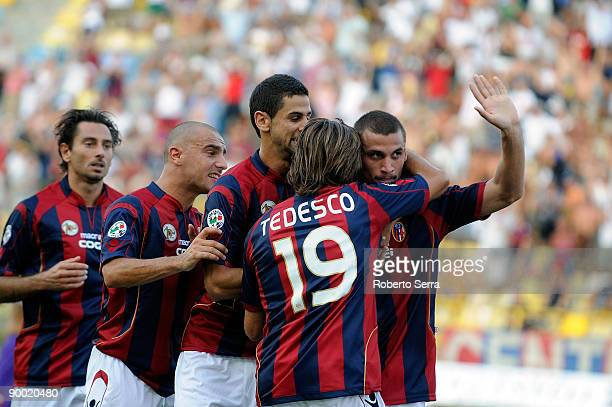 Pablo Osvaldo of Bologna celebrates with Giacomo Tedesco and teamates after scoring the opening goal of the Serie A match between Bologna and...