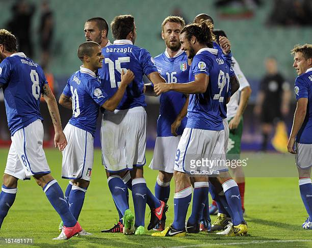 Pablo Osvaldo of Italy celebrates with Sebastian Giovinco 2nd L and teammates after scoring the opening goal of the FIFA 2014 World Cup Qualifier...
