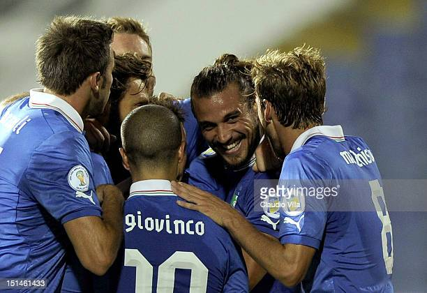 Pablo Osvaldo of Italy celebrates with teammates scoring the second goal for their team during the FIFA 2014 World Cup Qualifier match between...