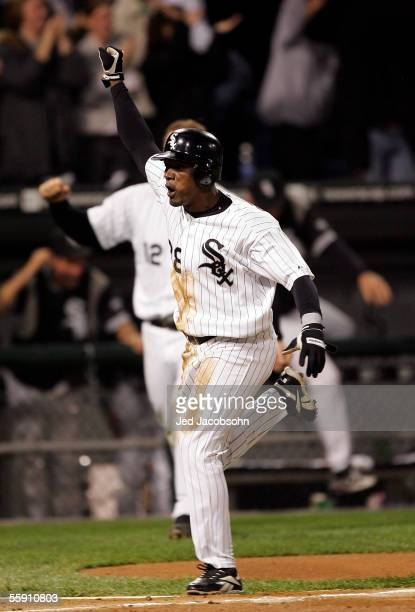 Pablo Ozuna of the Chicago White Sox celebrates the winning run after teammate Joe Crede#24 hit the game winning RBI double in the ninth inning of...