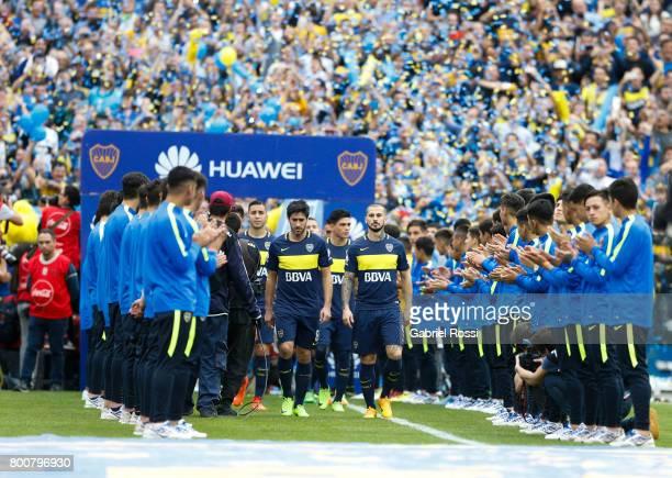 Pablo Perez and Dario Benedetto of Boca Juniors walk onto the field prior a match between Boca Juniors and Union as part of Torneo Primera Division...