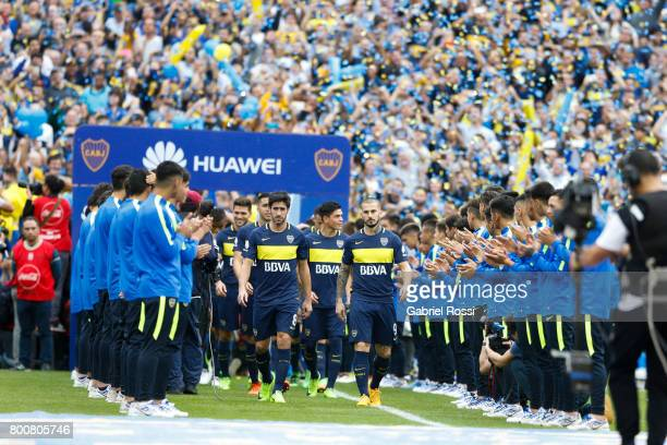 Pablo Perez and Dario Benedetto of Boca Juniors walk onto the field prior a during a match between Boca Juniors and Union as part of Torneo Primera...