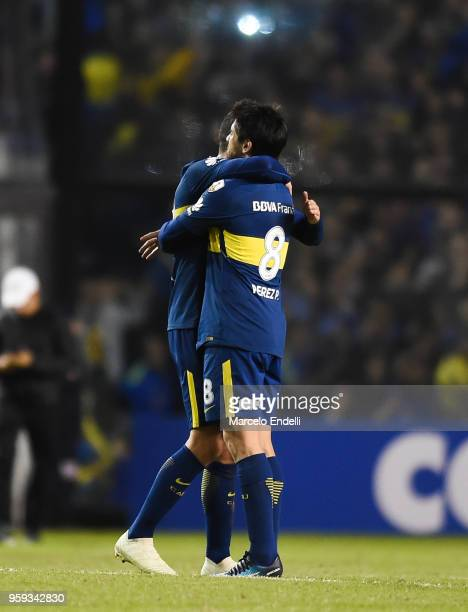Pablo Perez hugs Leonardo Jara of Boca Juniors after winning a match between Boca Juniors and Alianza Lima at Alberto J Armando Stadium on May 16...
