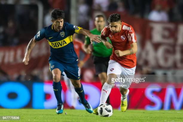 Pablo Perez of Boca Juniors and Martin Benitez of Independiente battle for the ball during a match between Independiente and Boca Juniors as part of...