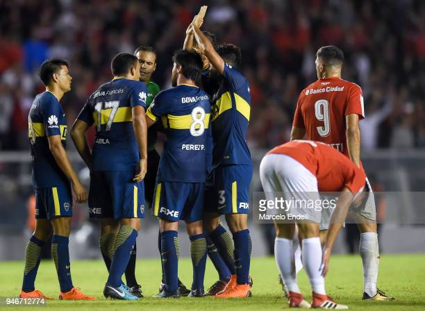 Pablo Perez of Boca Juniors argues with referee Ariel Penel during a match between Independiente and Boca Juniors as part of Superliga 2017/18 at...