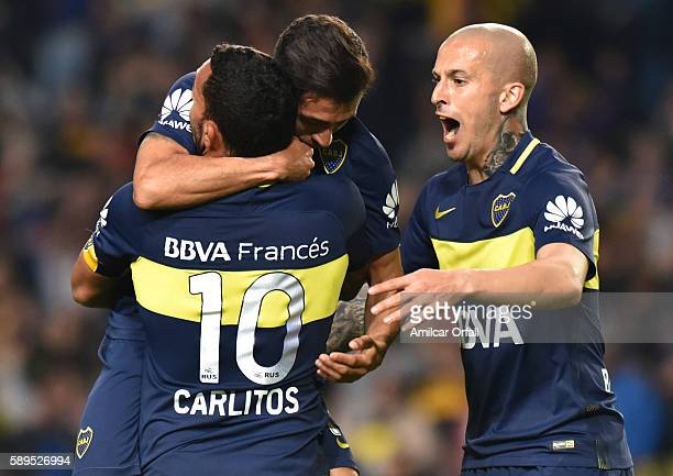 Pablo Perez of Boca Juniors celebrates with teammate Carlos Tevez after scoring the second goal of his team during a friendly match between Boca...