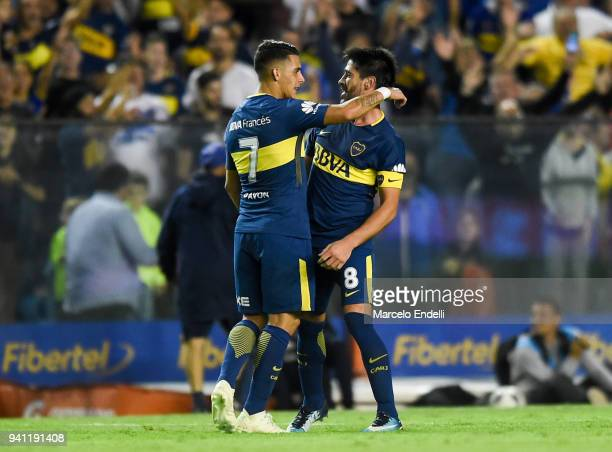 Pablo Perez of Boca Juniors celebrates with teammate Cristian Pavón after scoring the second goal of his team during a match between Boca Juniors and...