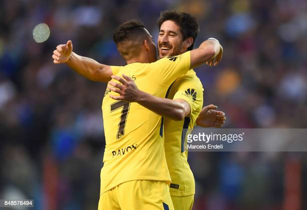 Pablo Perez of Boca Juniors celebrates with teammate Cristian Pavon after scoring the second goal of his team during a match between Boca Juniors and...