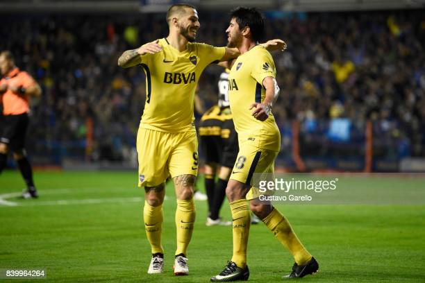 Pablo Perez of Boca Juniors celebrates with teammate Dario Benedetto after scoring the second goal of his team during a match between Boca Juniors...