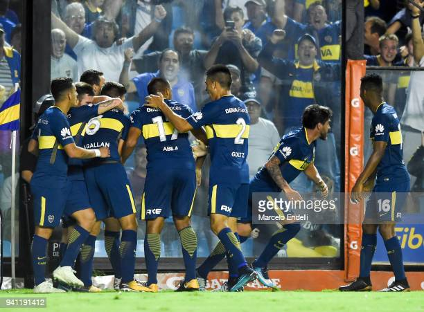 Pablo Perez of Boca Juniors celebrates with teammates after scoring the second goal of his team during a match between Boca Juniors and Talleres as...