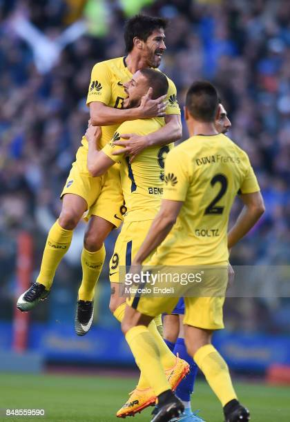 Pablo Perez of Boca Juniors celebrates with teammates Dario Benedetto and Paolo Goltz after scoring the first goal of his team during a match between...