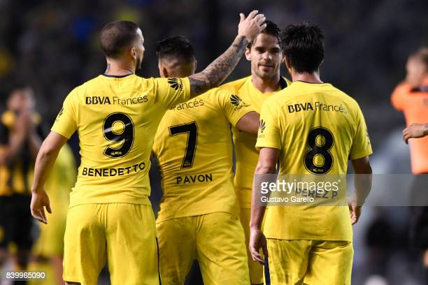 Pablo Perez of Boca Juniors celebrates with teammates Fernando Gago Cristian Pavon and Dario Benedetto after scoring the second goal of his team...