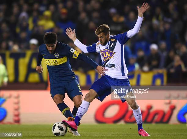 Pablo Perez of Boca Juniors fights for the ball with Gaspar Gentile of Alvarado during a match between Boca Juniors and Alvarado as part of Round of...
