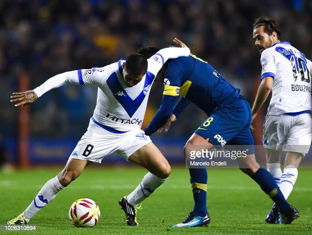 Pablo Perez of Boca Juniors fights for the ball with Jesus Mendez of Velez Sarsfield during a match between Boca Juniors and Velez as part of...