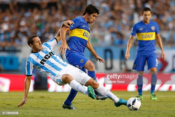 Pablo Perez of Boca Juniors fights for the ball with Luciano Aued of Racing Club during a fifth round match between Racing Club and Boca Juniors as...