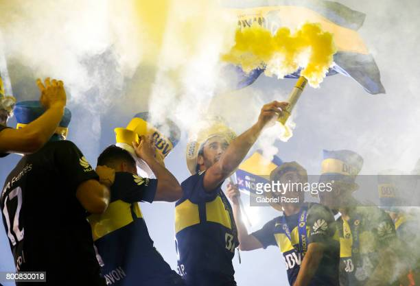 Pablo Perez of Boca Juniors holds a flare to celebrate the champions title after a match between Boca Juniors and Union as part of Torneo Primera...