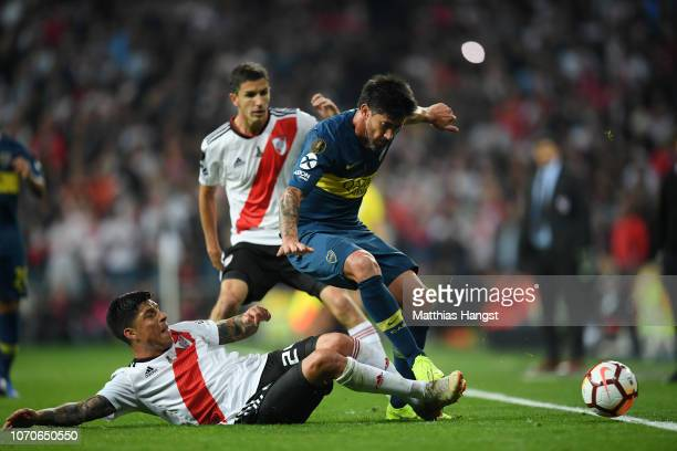 Pablo Perez of Boca Juniors is challenged by Enzo Perez of River Plate during the second leg of the final match of Copa CONMEBOL Libertadores 2018...
