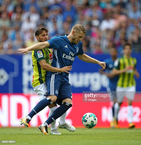 Pablo Piatti of Espanyol Barcelona and Aaron Hunt of Hamburg battle for the ball duringthe preseason friendly match between Hamburger SV and Espanyol...