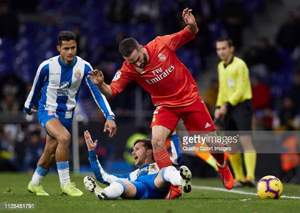 Pablo Piatti of Espanyol competes for the ball with Daniel Carvajal of Real Madrid during the La Liga match between RCD Espanyol and Real Madrid CF...