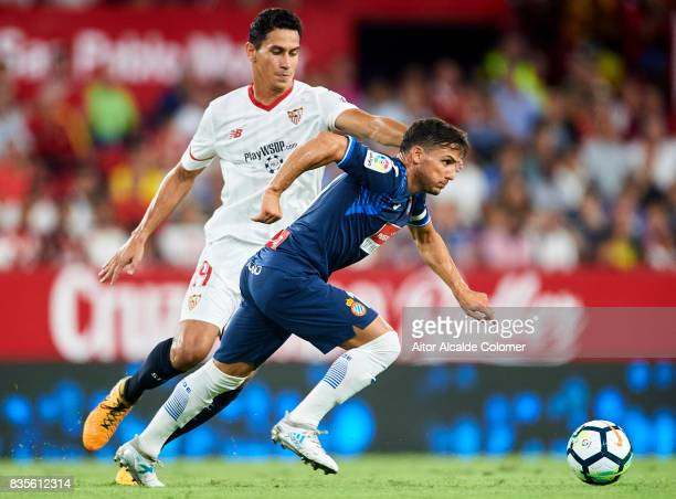 Pablo Piatti of RCD Espanyol being followed by Paulo Henrique Ganso of Sevilla FC during the La Liga match between Sevilla and Espanyol at Estadio...