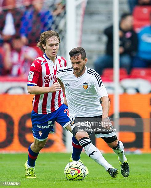 Pablo Piatti of Valencia CF duels for the ball with Halilovic of Sporting Gijon during the La Liga match between Sporting Gijon and Valencia CF at...