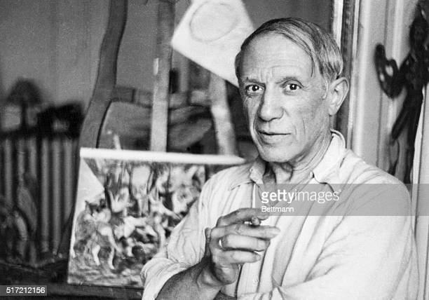 Pablo Picasso poses in his Paris studio