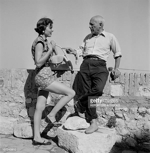 Pablo Picasso talks with a friend at the opening of his ceramics exhibition at the Antibes museum today known as the Picasso Museum the first museum...