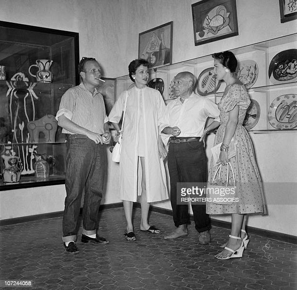 Pablo Picasso talks with friends at the opening of his ceramics exhibition at the Antibes museum today known as the Picasso Museum the first museum...