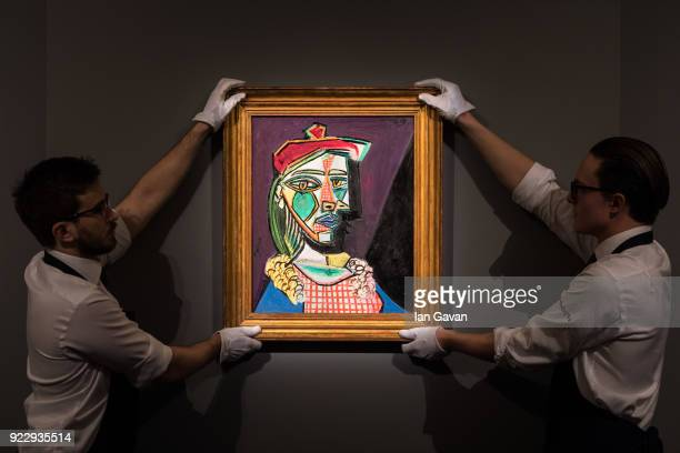 Pablo Picasso's Femme au beret et a la robe quadrillee goes on view during the press call before an auction dedicated to Impressionist artworks at...
