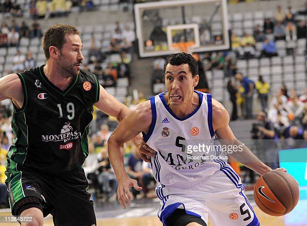 Pablo Prigioni #5 of Real Madrid competes with Marko Jaric #19 of Montepaschi Siena in action during the 3rd Place Playoff of Turkish Airlines Final...