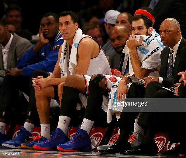 Pablo Prigioni and Jose Calderon of the New York Knicks react late in the fourth quarter against the Dallas Mavericks at Madison Square Garden on...