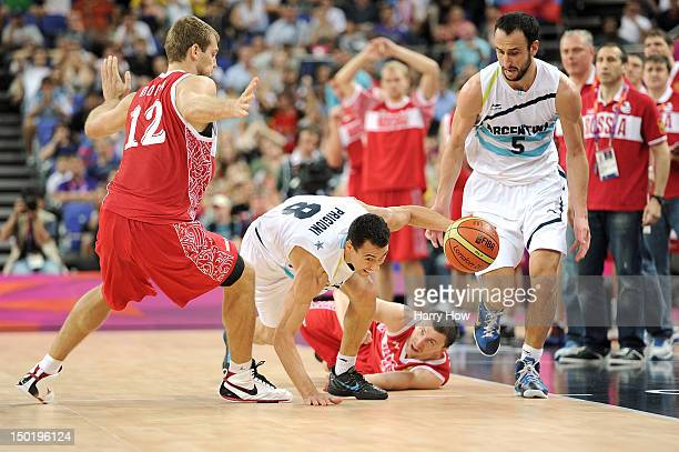 Pablo Prigioni of Argentina dribbles around Sergey Monya of Russia during the Men's Basketball bronze medal game between Russia and Argentina on Day...