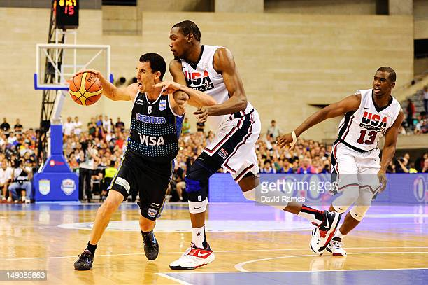 Pablo Prigioni of the Argentina Men's Senior National Team drives to the basket against Kevin Durant of the US Men's Senior National Team during a...