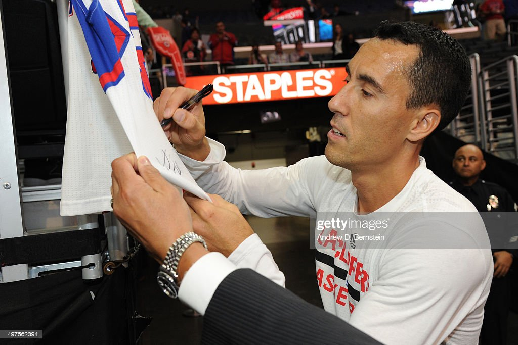 Pablo Prigioni #9 of the Los Angeles Clippers signs autographs for some fans before the game against the Golden State Warriors at STAPLES Center on October 20, 2015 in Los Angeles, California.