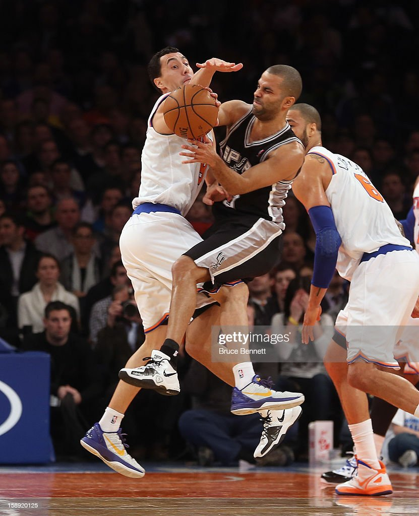 Pablo Prigioni #9 of the New York Knicks collides with Tony Parker #9 of the San Antonio Spurs at Madison Square Garden on January 3, 2013 in New York City.