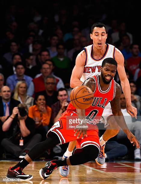 Pablo Prigioni of the New York Knicks guards Aaron Brooks of the Chicago Bulls in the fourth quarter during a game at Madison Square Garden on...