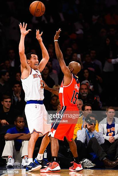Pablo Prigioni of the New York Knicks throws up the ball in front of John Lucas III of the Washington Wizards in a preseason game at Madison Square...