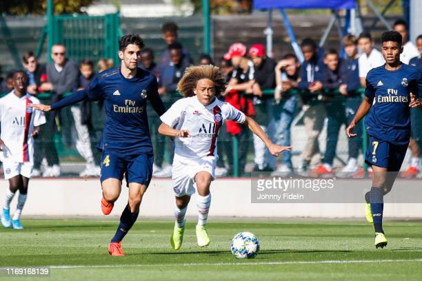 Pablo RAMON PARRA of Real Madrid and Xavi SIMONS of PSG during the Youth League match between Paris Saint Germain and Real Madrid at Camp des Loges...