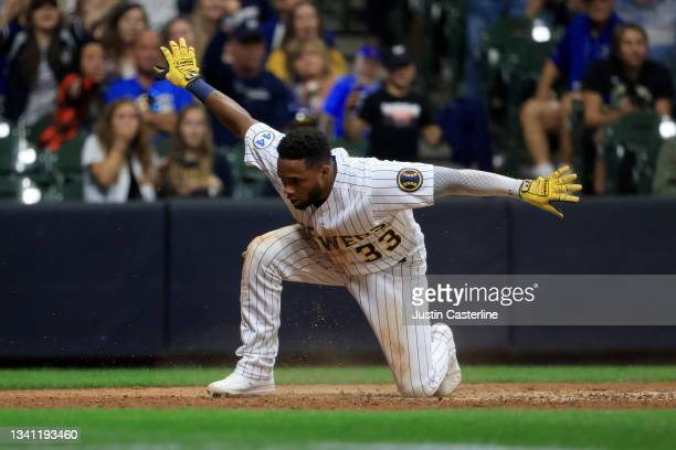 Pablo Reyes of the Milwaukee Brewers reacts after scoring a run during the eighth inning in the game against the Chicago Cubs at American Family...