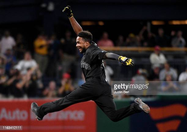 Pablo Reyes of the Pittsburgh Pirates reacts as he rounds the bases after hitting a walk-off RBI single to left field giving the Pittsburgh Pirates a...
