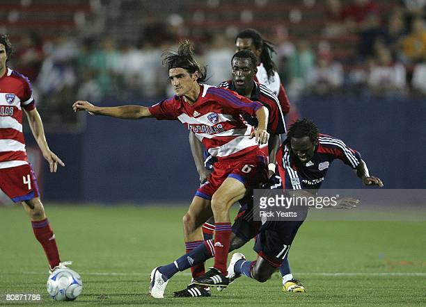 Pablo Ricchetti of FC Dallas take control the ball from the New England defense on April 24, 2008 at Pizza Hut Park in Frisco, Texas.