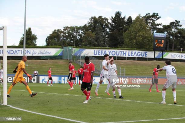 Pablo Rodriguez of Real Madrid injures himself celebrating after scoring weith a header to give the side a 1-0 lead during the match at Colovray...