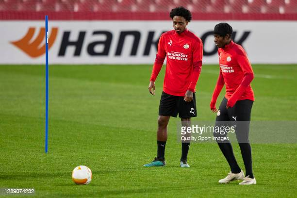 Pablo Rosario and Noni Madueke of PSV Eindhoven in action during training session ahead of the UEFA Europa League Group E stage match between PSV...