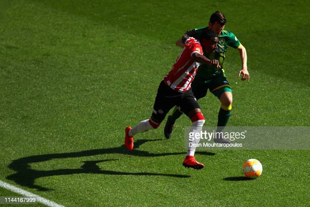 Pablo Rosario of PSV battles for the ball with Erik Falkenburg of ADO Den Haag during the Eredivisie match between PSV and ADO Den Haag at Philips...