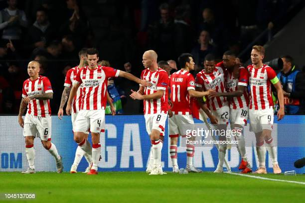 Pablo Rosario of PSV Eindhoven celebrates with teammates after scoring his team's first goal during the Group B match of the UEFA Champions League...