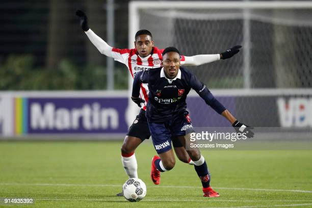 Pablo Rosario of PSV U23 Kelechi Nwakali of MVV Maastricht during the Dutch Jupiler League match between PSV U23 v MVV Maastricht at the De Herdgang...